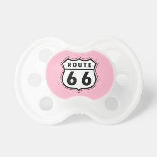 Señal de tráfico rosa clara de la ruta 66 chupetes de bebe