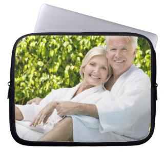 Senior Caucasian couple in robes in spa. Computer Sleeve