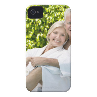 Senior Caucasian couple in robes in spa. iPhone 4 Cover