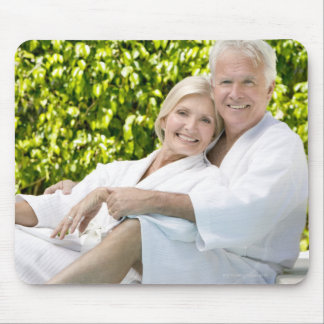 Senior Caucasian couple in robes in spa. Mouse Pad