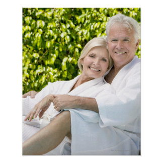 Senior Caucasian couple in robes in spa. Poster