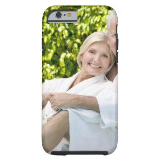 Senior Caucasian couple in robes in spa. Tough iPhone 6 Case