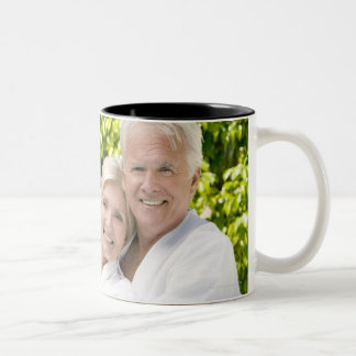 Senior Caucasian couple in robes in spa. Two-Tone Coffee Mug