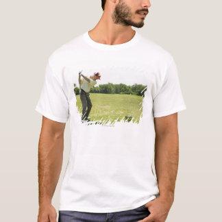 Senior golfer hitting practice balls at a range T-Shirt