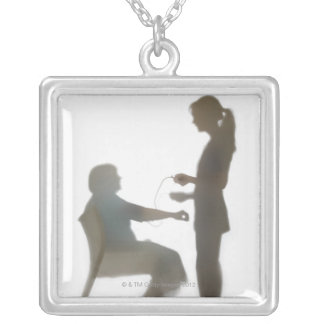 Senior health check / blood pressure reading silver plated necklace