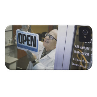 Senior male pharmacist hanging 'Open' sign in Case-Mate iPhone 4 Case