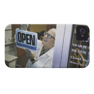 Senior male pharmacist hanging 'Open' sign in iPhone 4 Case-Mate Cases
