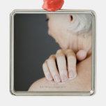 Senior woman applying moisturising cream to her ornaments