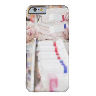 Senior woman comparing packages in drug store barely there iPhone 6 case