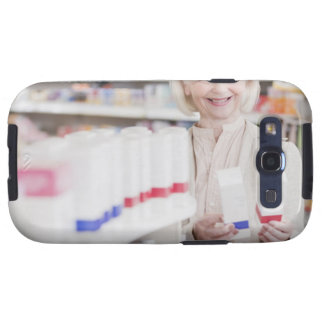 Senior woman comparing packages in drug store samsung galaxy s3 case