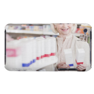 Senior woman comparing packages in drug store barely there iPod cases