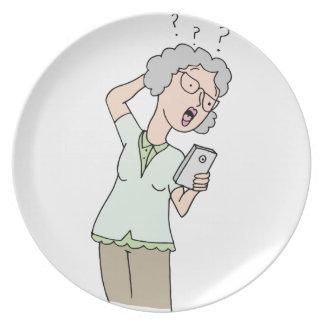 Senior woman confused new phone melamine plate