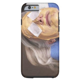 Senior woman having spa treament tough iPhone 6 case