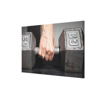 Senior woman lifting weights canvas print