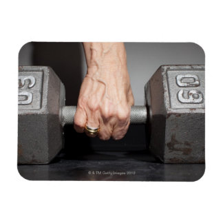 Senior woman lifting weights rectangle magnets