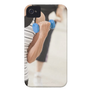 Seniors exercising with dumbbells in a health iPhone 4 case