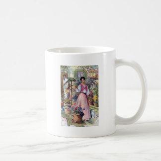 Señora con el loro y el gato por la hacienda taza