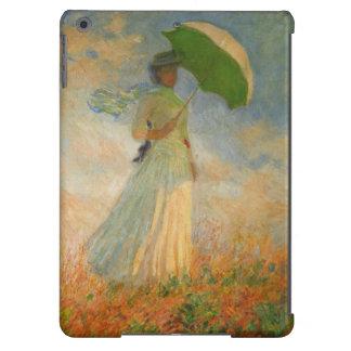 Señora con la caja del aire del iPad del parasol