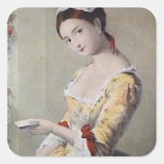 Señora con las tarjetas pegatina cuadrada