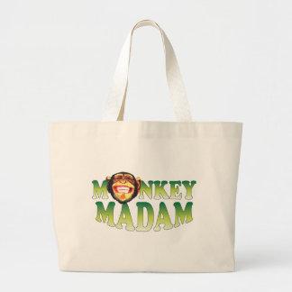 Señora del mono bolsa