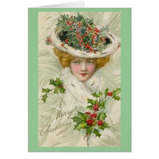 Señora del Victorian del navidad que sostiene una  Tarjeta De Felicitación