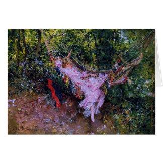 Señora en una hamaca en vestido rosado tarjeta de felicitación