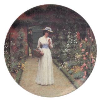 Señora en una pintura al óleo del jardín plato de comida