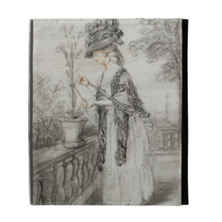 Señora en una terraza que tiende una planta del cl