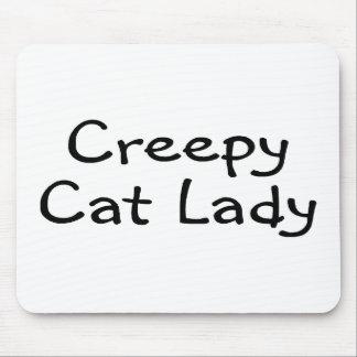 Señora espeluznante del gato tapete de ratón