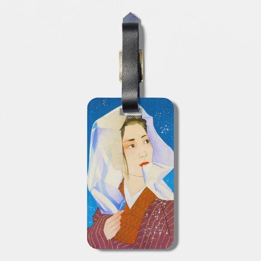 Señora japonesa clásica oriental fresca con el tej etiqueta para equipaje