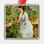 Señora joven en un invernadero ornamento de navidad