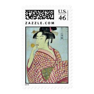Señora joven que sopla en poppin por Kitagawa, Uta Envio