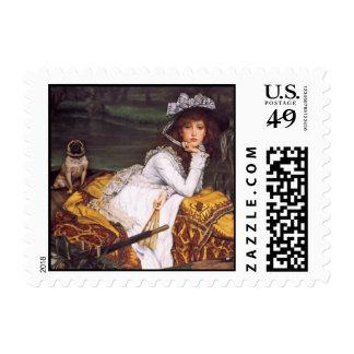 Señora joven y su barro amasado del mascota en un sellos postales