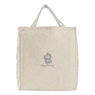 Señora loca del gato bolsas de mano bordadas