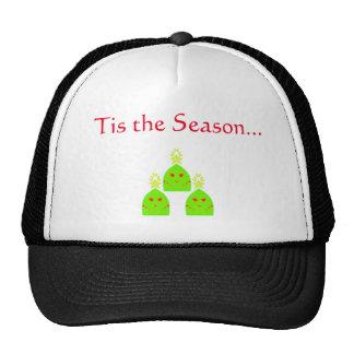 Señoras del árbol de navidad en los gorras