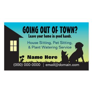 Sentada de la casa del mascota y tarjeta de visita