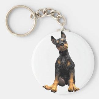 Sentada del perrito del Pinscher del Doberman Llavero Redondo Tipo Pin