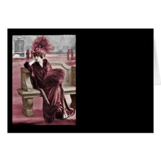 Sentada modelo en un banco tarjeta de felicitación