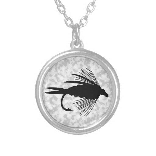 Señuelo negro de la pesca con mosca colgante redondo