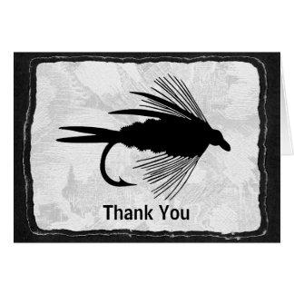 Señuelo negro de la pesca con mosca felicitacion