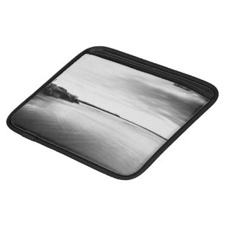 Serene expanse of water with rocky coast iPad sleeves