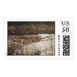 Serene rocks river and pebbles postage