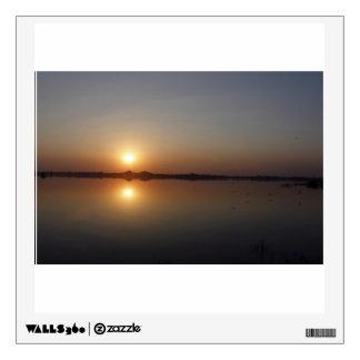 Serene sunset over water wall sticker