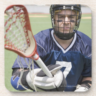 Serious lacrosse player holding crosse beverage coaster