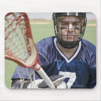 Serious lacrosse player holding crosse mouse pad