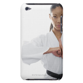 Serious woman doing martial arts barely there iPod cover
