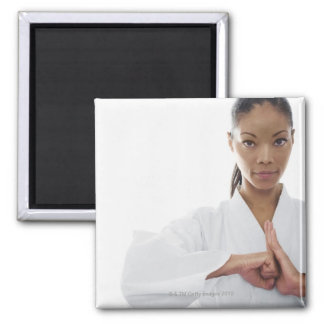 Serious woman doing martial arts magnet