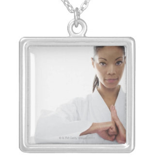 Serious woman doing martial arts necklaces