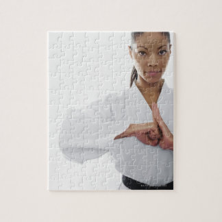 Serious woman doing martial arts jigsaw puzzles