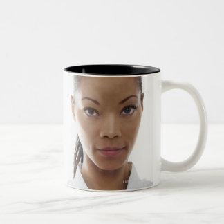 Serious woman doing martial arts Two-Tone coffee mug